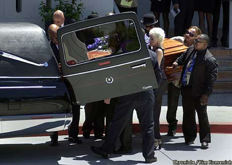 After yesterday's memorial service for John Lee Hooker at the Mormon Temple in the Oakland hills, unidentified pallbearers carried Hooker's coffin. Chronicle photo by Kim Komenich