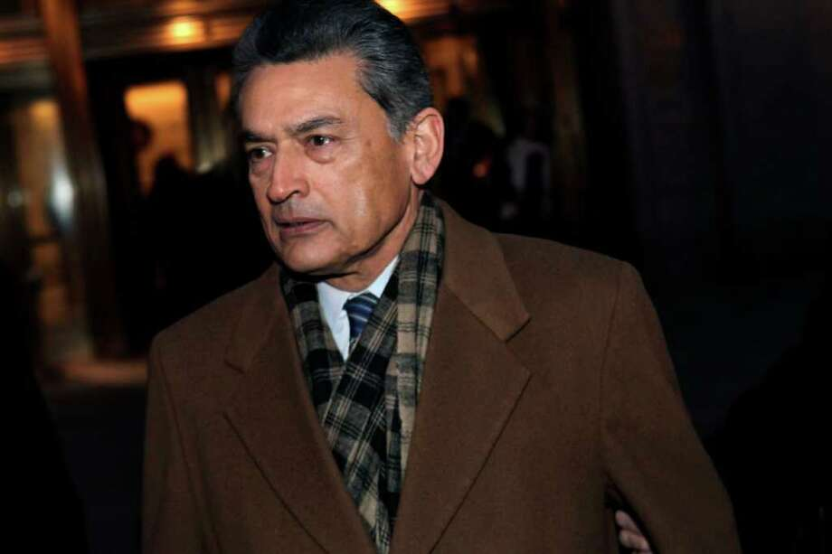 Former Goldman Sachs board member Rajat Gupta exits Manhattan federal court after a pre-trial hearing Thursday, Jan. 5, 2012 in New York. Gupta, of Westport, Conn., was charged last year with conspiracy and securities fraud. Free on $10 million bail, he faces trial April 9. (AP Photo/Seth Wenig) Photo: Seth Wenig, Associated Press / AP