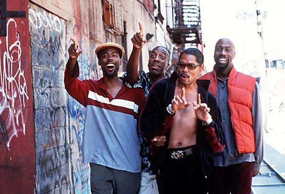 "Chris Rock, J.B. Smoove, Lance Crouther and Mario Joyner in ""Pootie Tang."" Paramount Pictures photo by K.C. Bailey via Associated Press"