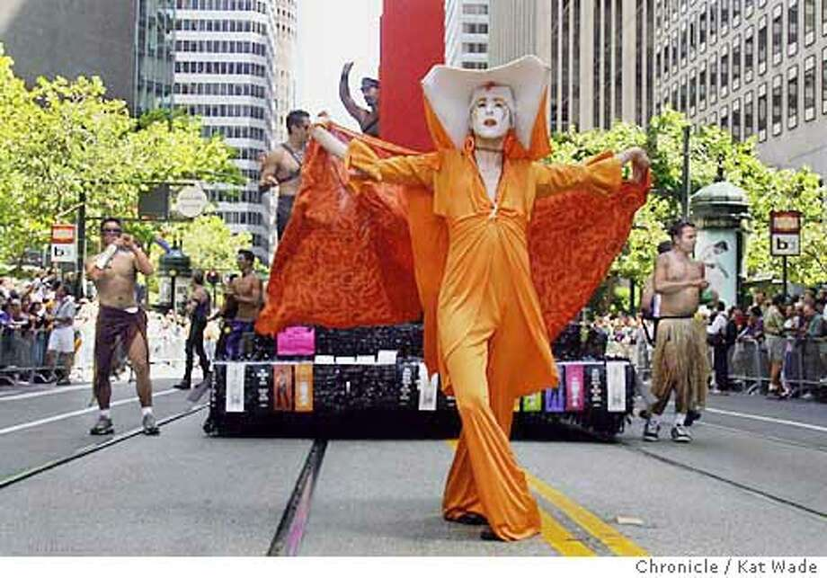 Sister Unity from the Los Angeles branch of The Sisters of Perpetual Indulgence struts her stuff down Market Street in front of the Smirnoff Twist Vodka float during the 31st annual San Francisco Pride 2001 . SAN FRANCISCO CHRONICLE PHOTO BY KAT WADE Photo: KAT WADE