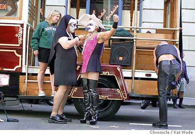 Sister Gina Tonic of The Sisters of Perpetual Indulgence helps sister Buffy with her/his costume beofre the 31st annual San Francisco Pride 2001 . SAN FRANCISCO CHRONICLE PHOTO BY KAT WADE Photo: KAT WADE