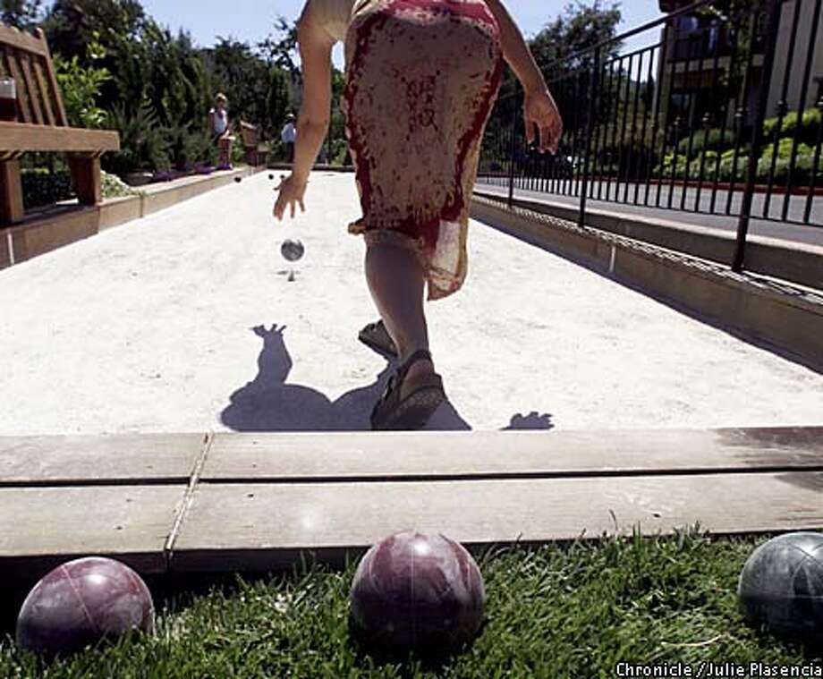 Christen Kerbs rolled the ball at the Villagio Spa in Yountville, where guests can borrow the bocce set from the front desk. Chronicle photo by Julie Plasencia