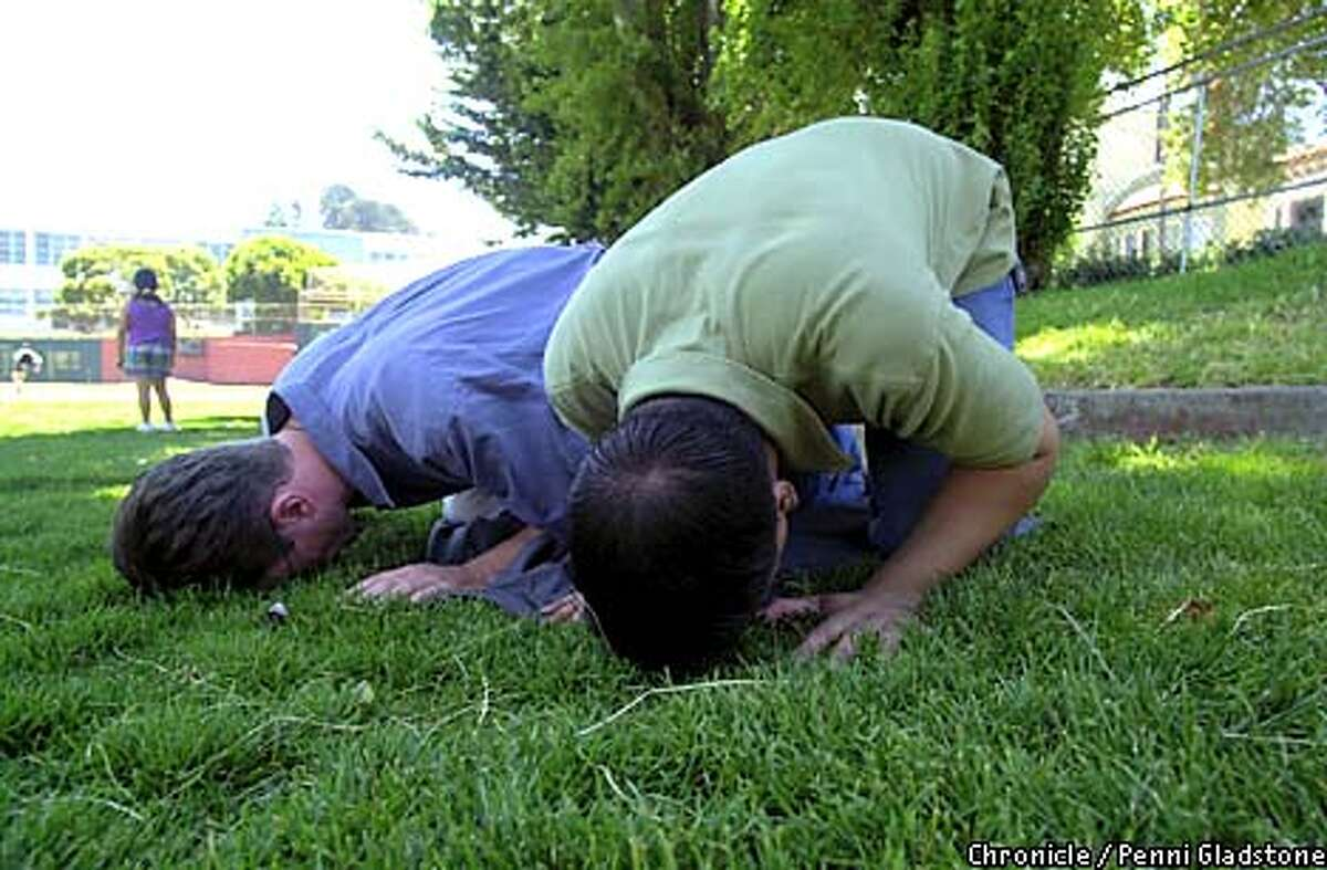 Mark Brustman, left, and Faisal Alam of the Al-Fatiha Foundation prayed at Collingwood Park in San Francisco's Castro district. The group, which is holding a three-day conference in the city, has between 1,500 and 2,000 members in nine chapters in the United States, Canada and England. Chronicle photo by Penni Gladstone