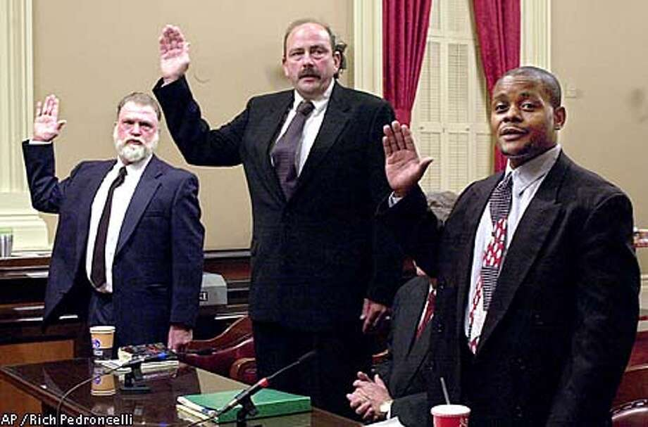 "Jimmy Olkjer, left, Glenn Johnson and Ed Edwards, former workers at Duke Energy's plant in Chula Vista, were sworn in before a state Senate committee in Sacramento. Talking about the changing levels of output, Johnson said, ""In my opinion, there was no reason to do this except supply and demand."" Associated Press photo by Rich Pedroncelli"