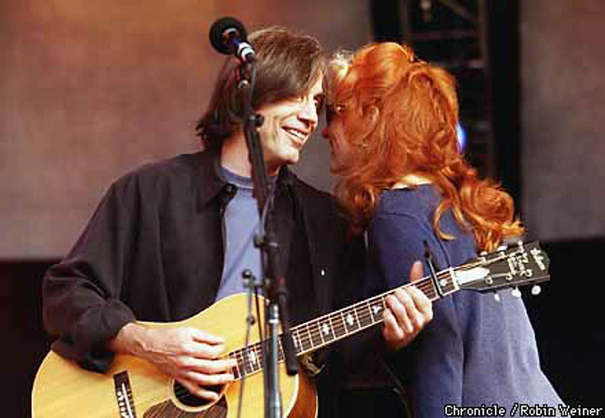 Jackson Browne and Bonnie Raitt shared a moment during the Shoreline Amphitheatre concert that also featured Shawn Colvin and Bruce Hornsby. Chronicle Photo by Robin Weiner
