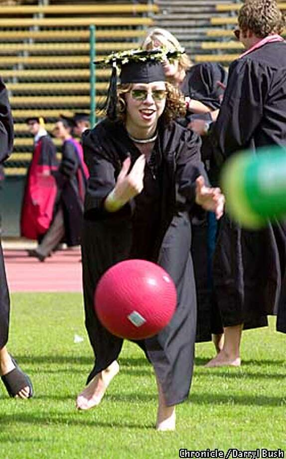 "CHELSEA5-C-17JUN01-MT-DB Chelsea Victoria Clinton throughs a ball as she plays inpromptu during festivities called the ""whacky walk"" a tradition as graduates enter the Stanford Stadium for the 110th Stanford University Commencement ceremonies Chelsea was attending to recieve her Bachelor of Arts, History degree. Chronicle Photo by Darryl Bush Photo: Darryl Bush"