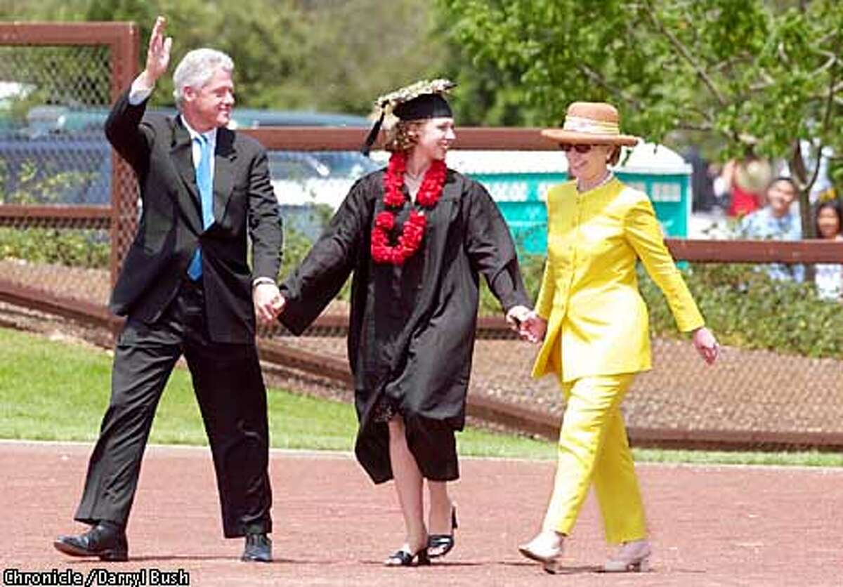 CHELSEA8-C-17JUN01-MT-DB Senator Hillary Clinton and former President Bill Clinton walk with their daughter, Chelsea Victoria Clinton, as they go to her graduation, after watching the 110th Stanford University Commencement ceremonies at Stanford Stadium. Chelsea was there to recieve her Bachelor of Arts, History degree. Chronicle Photo by Darryl Bush