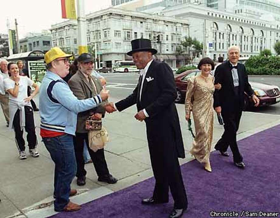 WILLIE-11SEP99-MN-SD--As Willie Brown was walking to the Opera House in his opening night finery, he shakes the hands of some of his constituents along Van Ness Avenue. By Sam Deaner/Chronicle Photo: SAM DEANER