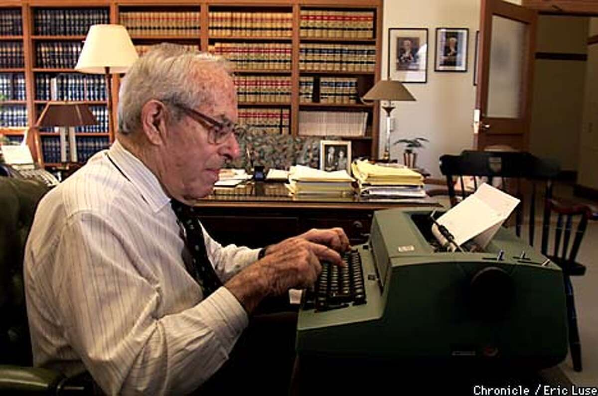 Justice Stanley Mosk used an IBM typewriter to work in his office in this photograph from two years ago. Chronicle photo by Eric Luse