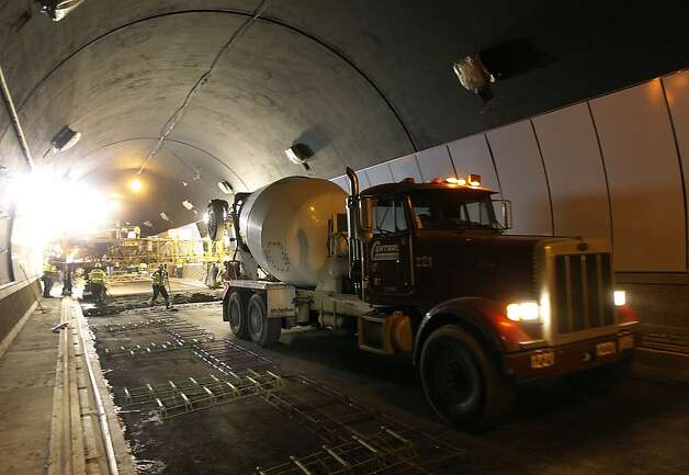 A cement truck leaves the northbound bore of the Devil's Slide tunnel project after delivering concrete for the road bed in Pacifica, Calif. on Tuesday, Jan. 31, 2012. Caltrans is hoping to open the two bores to traffic by the end of the year. Photo: Paul Chinn, The Chronicle