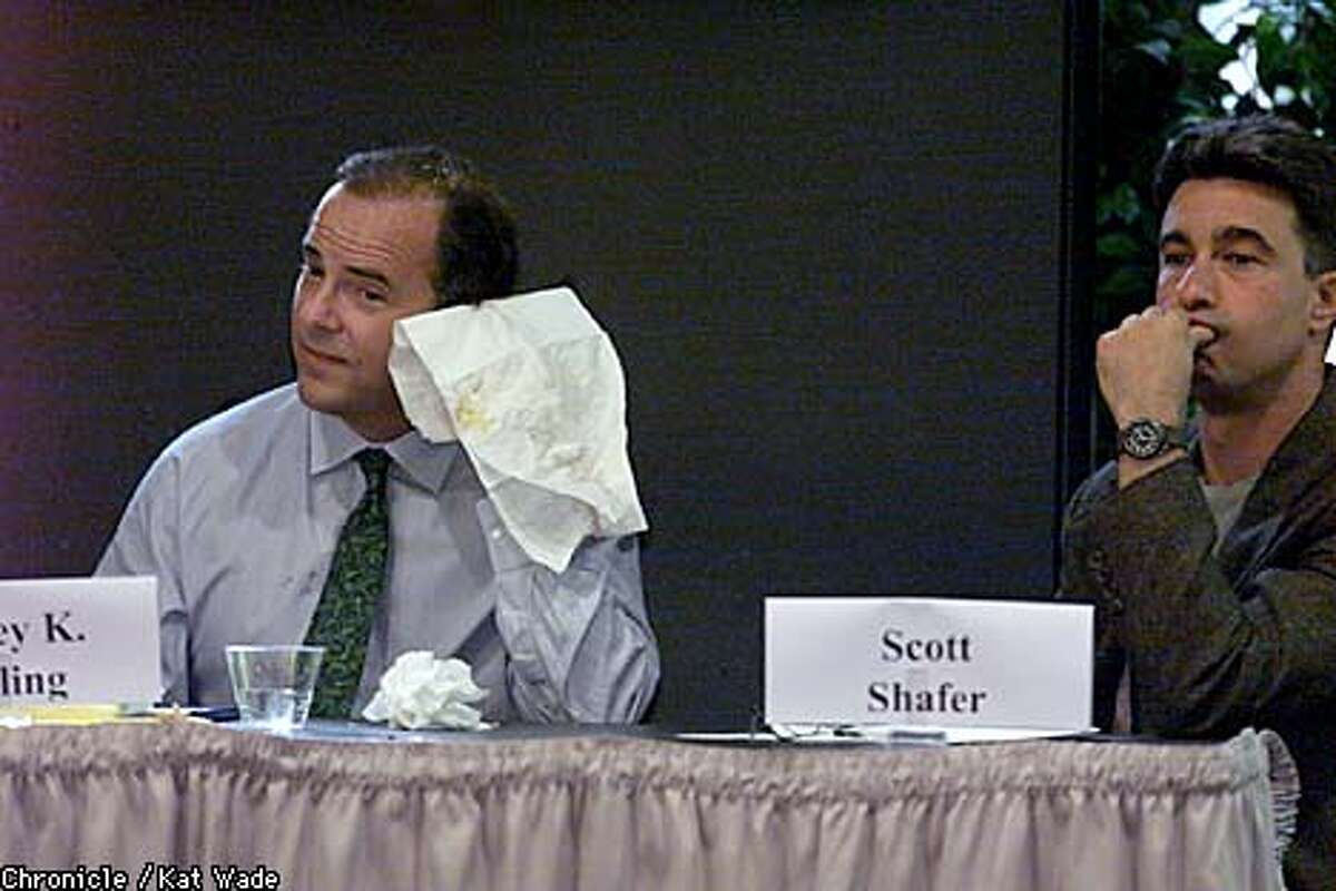 At the Commonwealth Club last night, Enron executive Jeff Skilling wiped pie from his face as moderator Scott Shafer sat at his left. Chronicle photo by Kat Wade