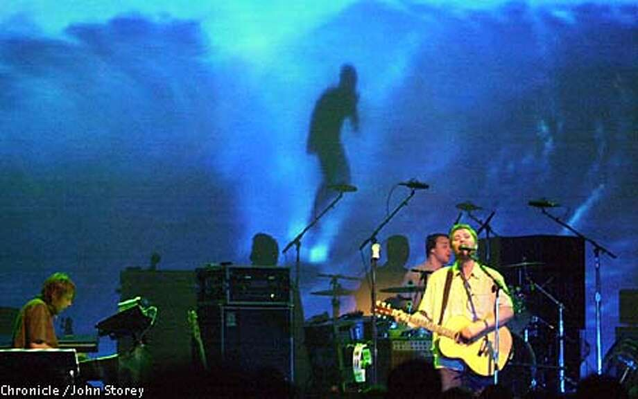 Doves singer-bassist Jimi Goodwin led the Manchester trio's concert at the Fillmore. Chronicle photo by John Storey