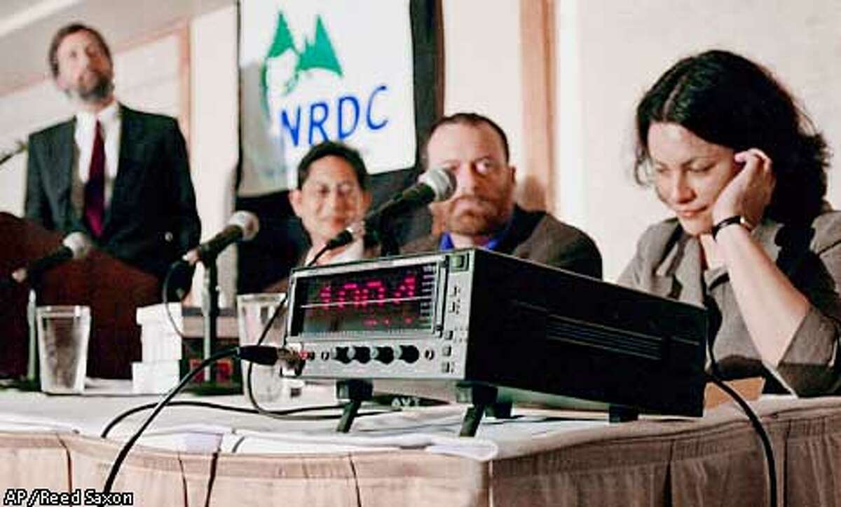 Dr. Naomi Rose, right, a marine mammal scientist with the Humane Society of the United States, covers her ears during a demonstration of low frequency sound that exceeds 100 decibels, at a news conference where plans were announced to fight a new U.S. Navy sonar system they and others claim will harm marine life, Thursday, April 26, 2001, in Santa Monica, Calif. The navy's system, Low Frequency Active (LFA) sonar, emits sound waves at up to 240 decibels, which researchers say may have harmful effects on the ocean's marine life, especially mammals such as whales. Opponents assert more research is needed to determine the affects of LFA sonar, and are asking the National Marine Fisheries Service not to exempt the Navy from applicable environmental laws. Others, from left, are Joel Reynolds, senior attorney with the National Resources Defense Council, Dr. Rod Fujita, a scientist with Environmental Defense, and Marc J. Spalding, an environmenta law professor at the University of California-San Diego. (AP Photo/Reed Saxon)
