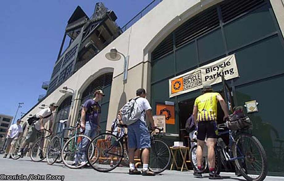 Giants fans dropped off their bikes before a game at Pacific Bell Park. Chronicle photo by John Storey