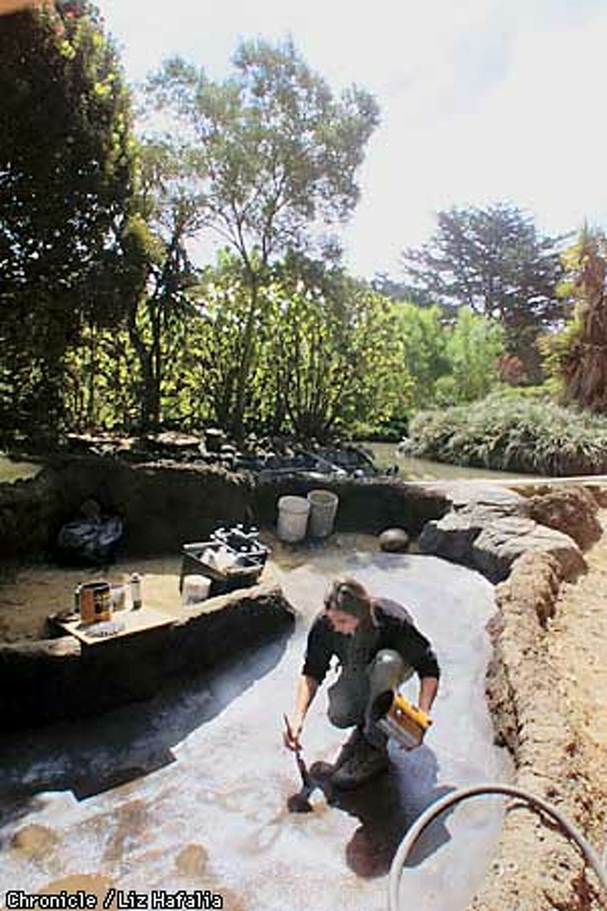 Eric Krussman working on the new home for turtles at the Children's Zoo. (BY LIZ HAFALIA/THE SAN FRANCISCO CHRONICLE)