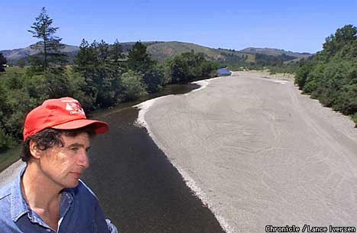 Michael Evenson a Petrolia Calif rancher Over looks the Mattole River. Erosion up stream do to clear cutting over many years as deposited tons of gravel into the river, some spots measuring four feet deep. The gravel has changed the rivers path with most of the water trapped under the gravel. By LANCE IVERSEN/SAN FRANCISCO CHRONICLE