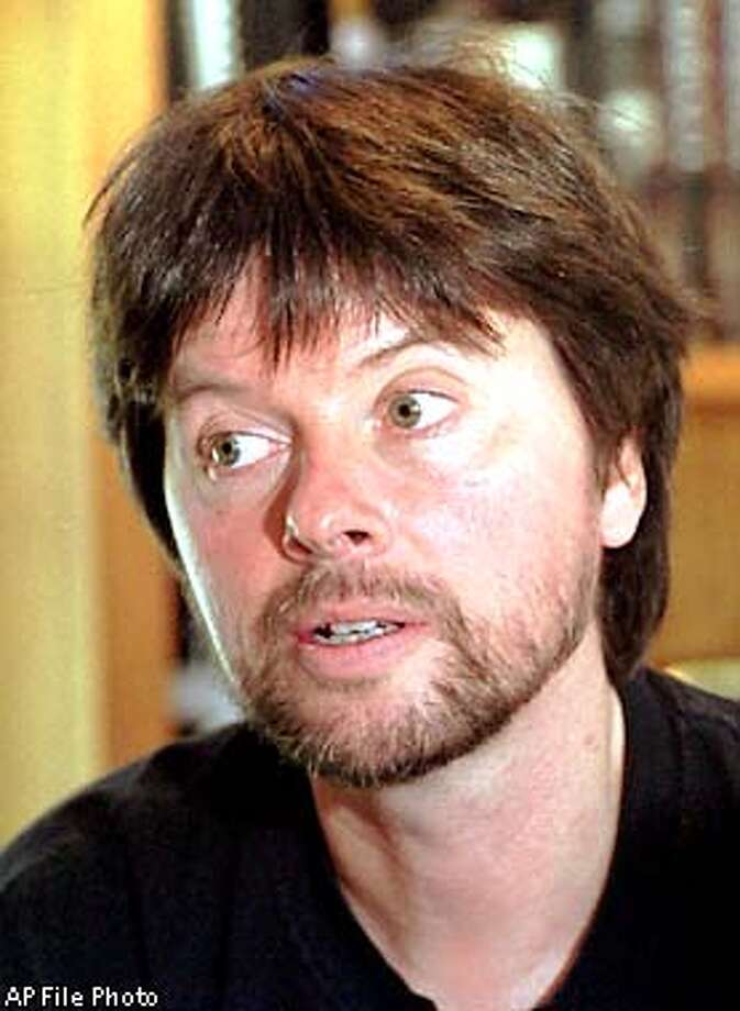 FILE--Film maker Ken Burns talks about his soon to be released film on Jazz in this Sept. 27, 2000 file photo, in his Walpole, N.H. office. Burns' 19-hour documentary wasn't among the movies at this year's Denver Jazz Film Festival, but that didn't prevent many festival attendees from critiquing it. Burns has said the recent PBS documentary is the last in a trilogy that began with 1990's ``The Civil War'' and was followed by 1994's ``Baseball.'' (AP Photo/Lee Marriner, File) Photo: LEE MARRINER