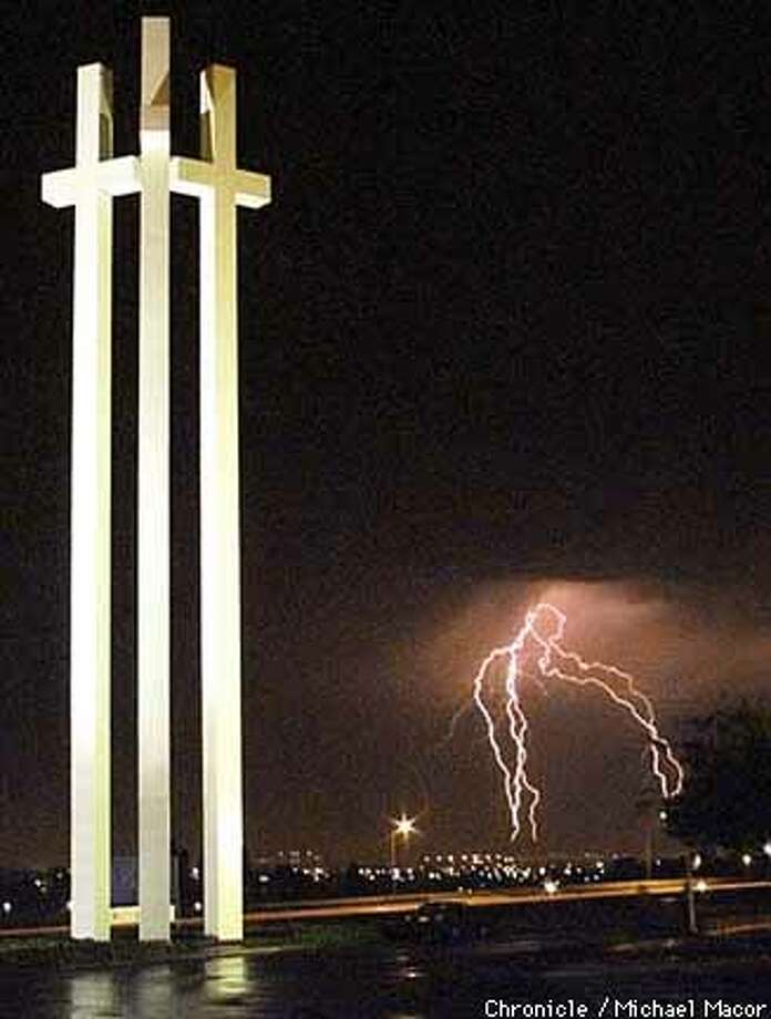 LIGHTNING02-C-08SEP99-MN-MAC Lightning strikes over San Leandro above the I580 freeway. Crosses at the Crossroads Community Church in Castro Valley. by Michael Macor/The Chronicle