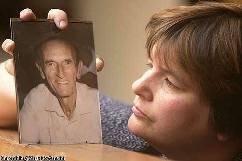 PAIN03-C-02MAY01-EZ-MC. Beverly Bergman looks at a photograph of her late father William Bergman who she claims was denied adequate pain medication in his final days. Photo: Mark Costantini/The Chronicle.