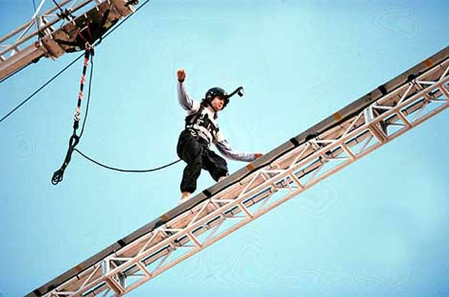 "FEAR FACTOR -- NBC Alternative Series -- Pictured: contestant in the ""Beam Walk"" competition -- NBC Photo by: Carolyn Kaster"