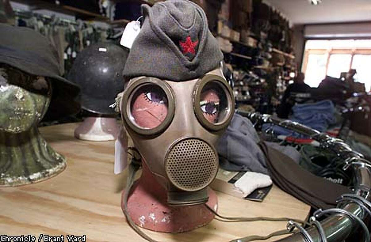 Gas masks, many from Eastern-bloc countries, are surplus-store staples. Chronicle photo by Brant Ward