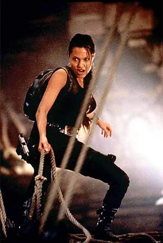 "Angelina Jolie tries -- at least at times -- to keep an ancient gold triangle from falling into the wrong hands in ""Lara Croft: Tomb Raider."""