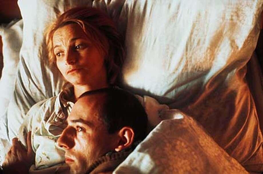 "Anna Siskova and Csongor Kassai in ""Divided We Fall."""