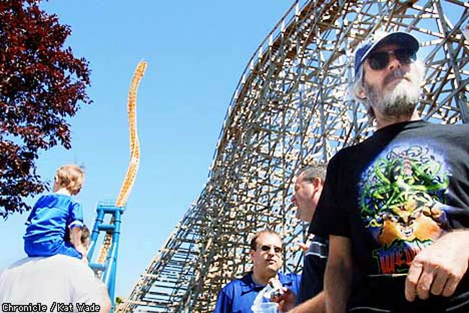 ACE American Coaster Enthusiast member, Rick Widger(right) of Hayward was undaunted by the delay in the grand opening of the new roller coaster, The Veretical Limit, at Six Flags Marine World in Vallejo. The coaster's debu was held up by software glitches. SAN FRANCISCO CHRONICLE PHOTO BY KAT WADE Photo: KAT WADE