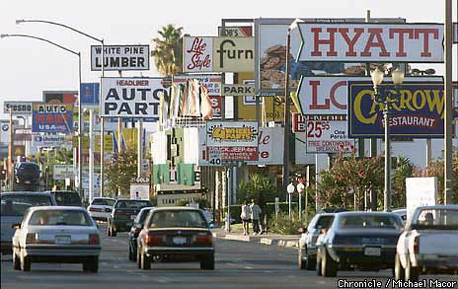 Dozens of business signs of all sizes and shapes compete for attention alongBlackstone Avenue in the heart of Fresno. Chronicle Photo by Michael Macor
