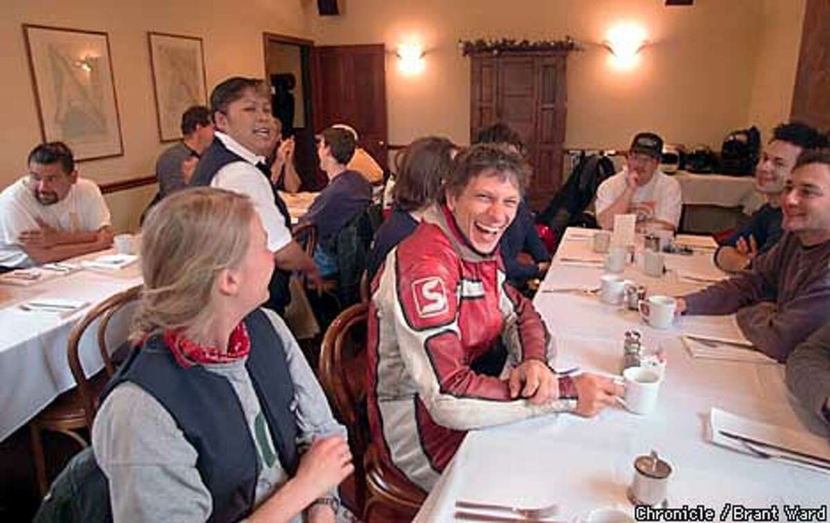 At end of their weekly ride, the motorcyclists always breakfast at the Station House Cafe in Point Reyes. Here Michael Leister, center, breaks into laughter after being told by longtime waitress Sandra Roman that he's a lousy tipper. By Brant Ward/Chronicle
