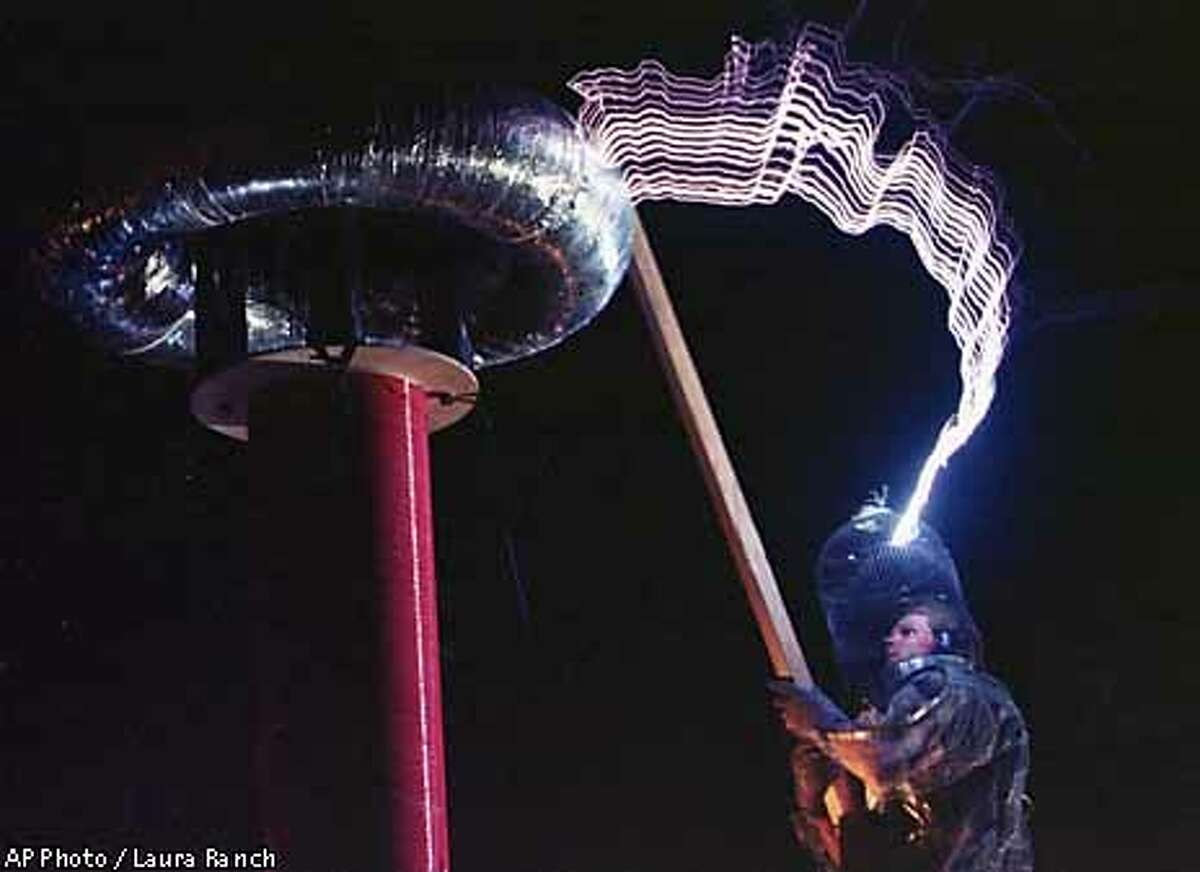 Mr. Mega Bolt creates lightning bolts as an expression of performance art during the festival in the Black Rock Desert near Gerlach, Nev. on Thursday, Sept. 2, 1999. The gathering, intented to be a celebration of radical free expression and self reliance, will host 20,000 people before its culmination on Saturday. (AP Photo/Laura Rauch)