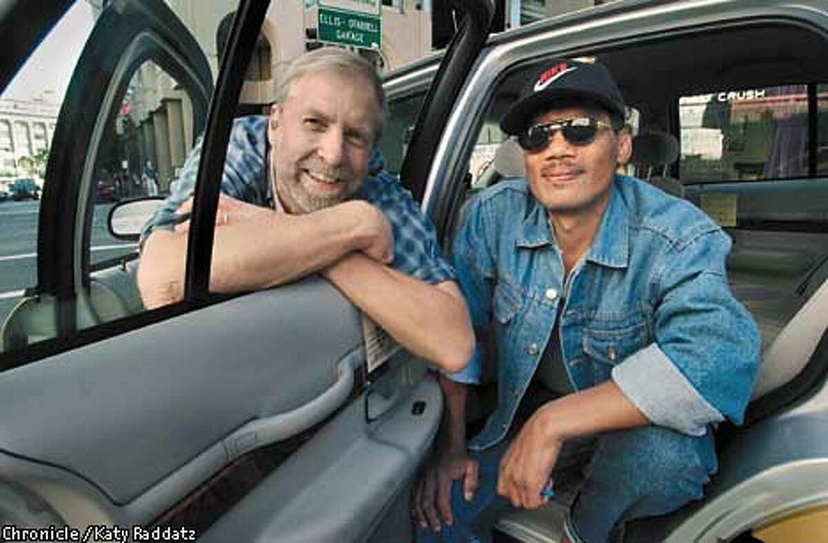 NEWSHAM12c-C-09JUN01-SF-RAD Photo by Katy Raddatz--The Chronicle Cabbie and author Brad Newsham (white guy) and his friend Tony Tocdaan (cq) in Brad's cab--they'll cruise around for the night picking up fares and having adventures.