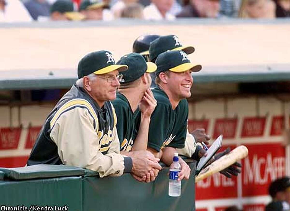 The Oakland Athletics' left-handed pitcher Mark Mulder (center) hangs out with teammates and watches the action during their game against the Tampa Bay Devil Rays. (KENDRA LUCK/SAN FRANCISCO CHRONICLE)