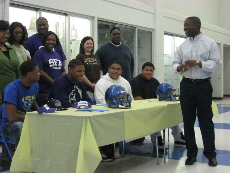 Signing for Ozen High School on Wednesday were football players  (from left to right) Trey Green (Prairie View), Terran Vaughn (SFA), Thalan Payne (Missouri Valley College) and Thomas Payne (Missouri Valley College). Photos by David Henry/The Enterprise. Photo: David Henry