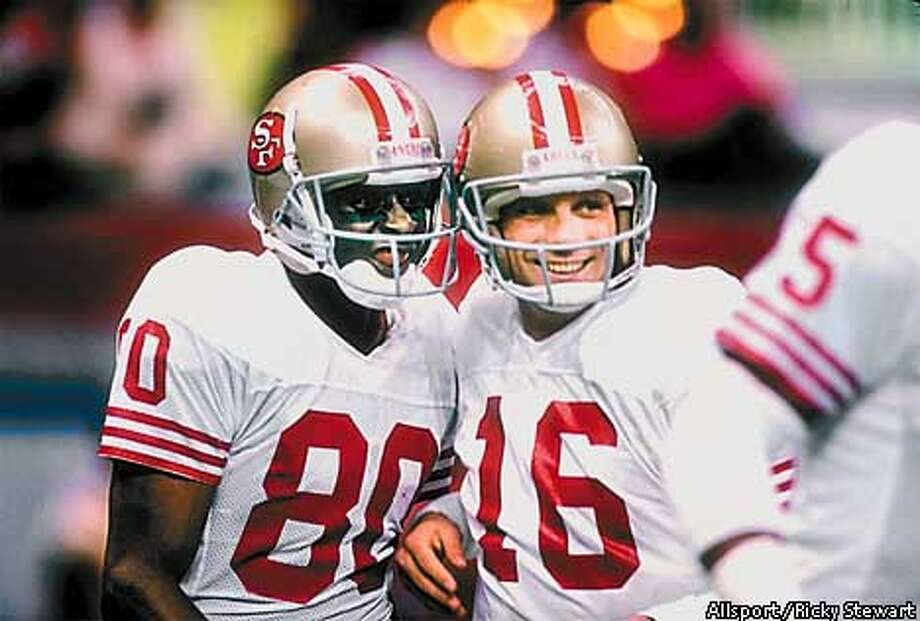 503425c1834 28 Jan 1990  San Francisco 49ers quarterback Joe Montana (right) and wide  receiver