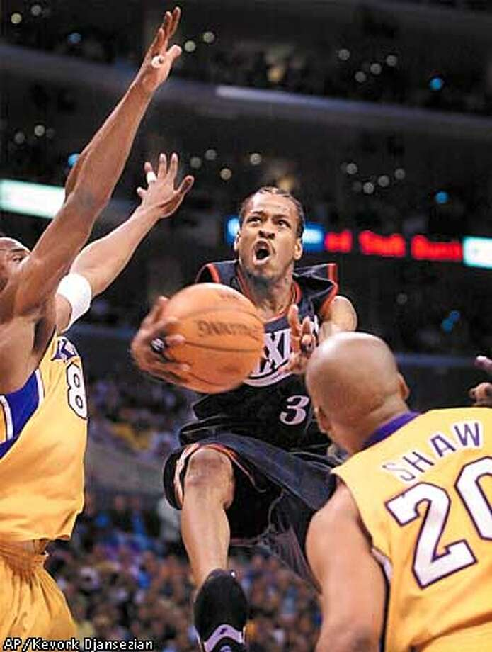 82221ee872a Philadelphia 76ers' Allen Iverson drives to the basket against Los Angeles  Lakers' Kobe Bryant