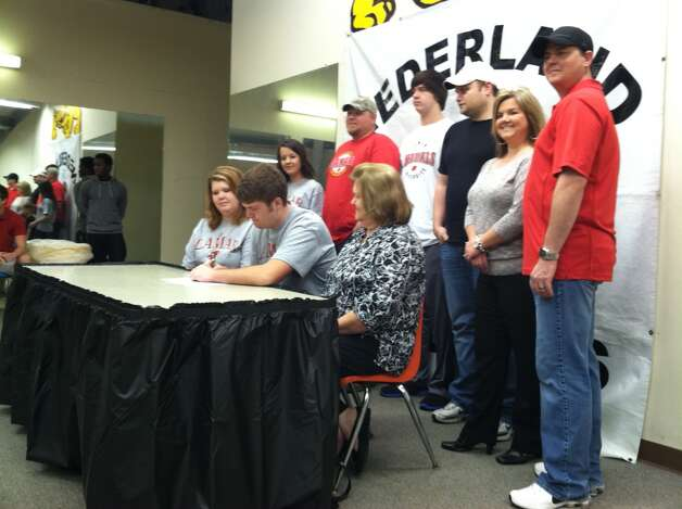 Nederland senior Corbin Carr signs a letter of intent to play football at Lamar University. Photo by Christopher Dabe/The Enterprise.