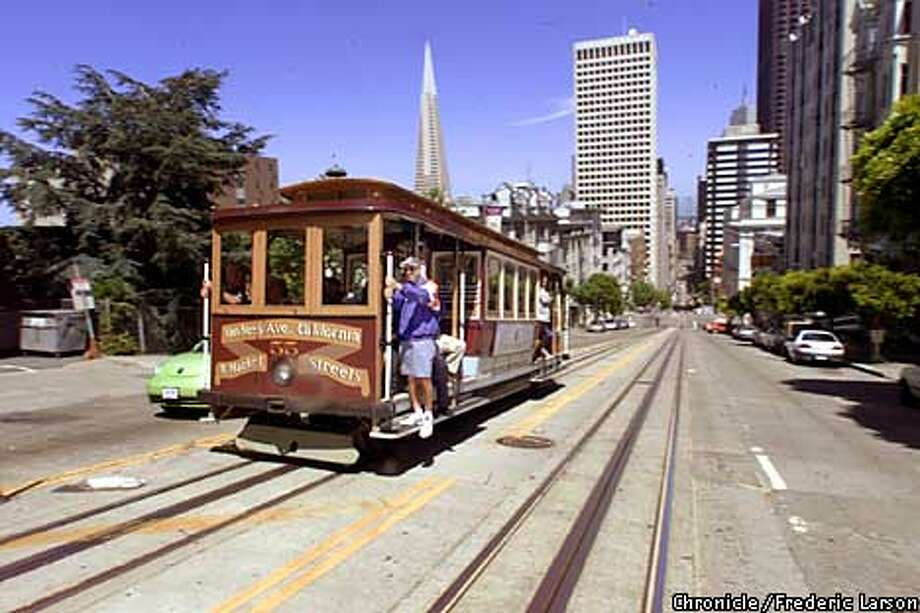 MUNI1-04JUN01-MT-FRL: San Francisco Cable Cars are now in favor in being on time, better service and shorter waits for the customer. SF skyline in background as a car reaches the top of California on Nob Hill. Chronicle photo by Frederic Larson Photo: FREDERIC LARSON