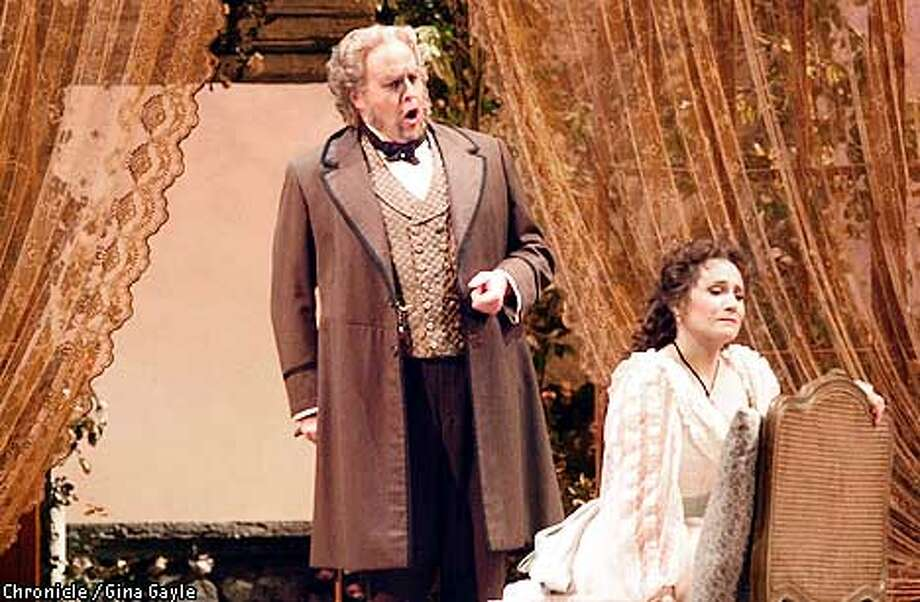 "Christopher Roberston plays Giorgio Germont, Alfredo's father, and comes to talk Violetta (patricia Racette) into leaving his son in the second act of ""La Traviata"". Photo by Gina Gayle/The SF Chronicle. Photo: GINA GAYLE"