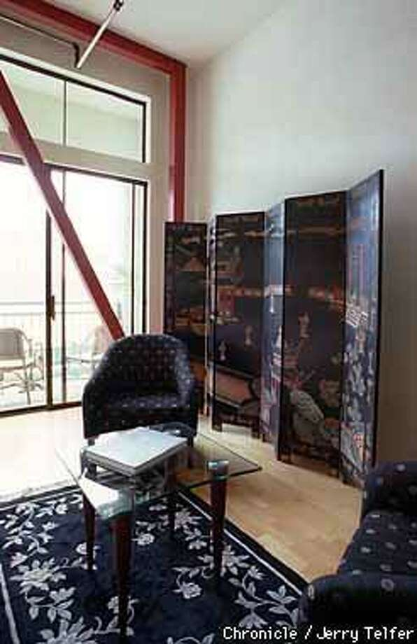 LOFT SOLUTION: A painted Asian screen helped break the line of a long, plain wall. Chronicle Photo by Jerry Telfer