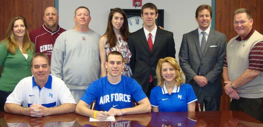 Cinco Ranch High wide receiver Alex Ludowig has committed to the Air Force Academy. Pictured are, seated: Rick (dad), Alex and Brenda (mom); standing: Shannon Valdivia (counselor), Erik Hammond (coach), Jon Edwards (coach), Nicole (sister-in-law), Matthew (brother), James Cross (principal) and Don Clayton (coach). Photo: Handout Photo