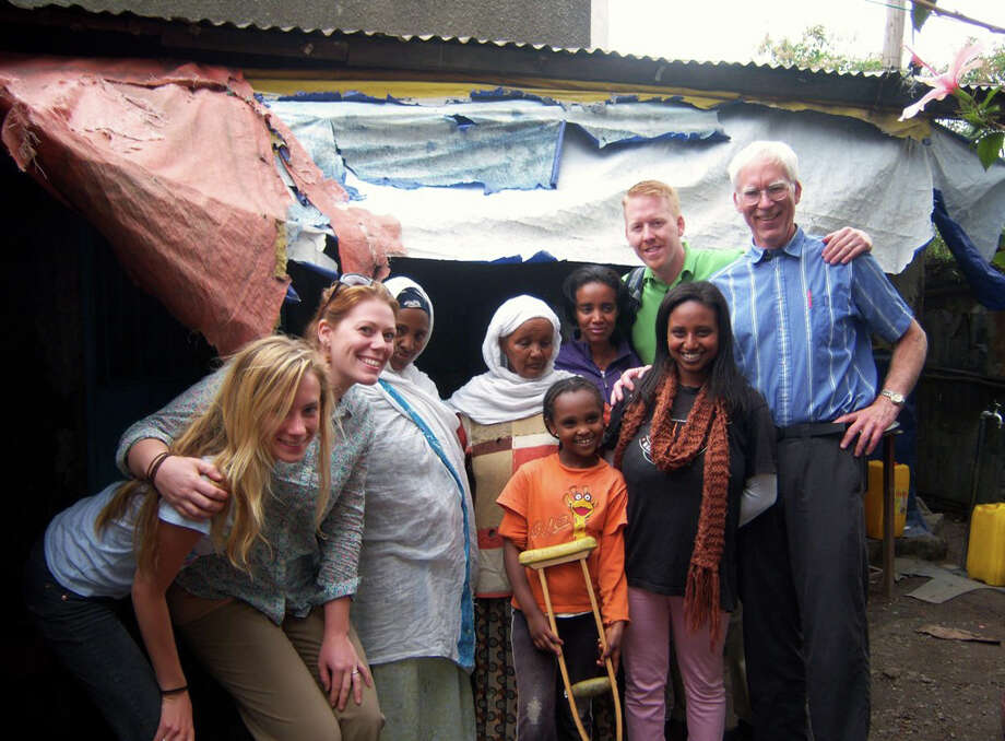 Jim Rumsey and Tim Erickson visit a CURE patient's home in Addis Ababa, Ethiopia. Photo: Contributed Photo