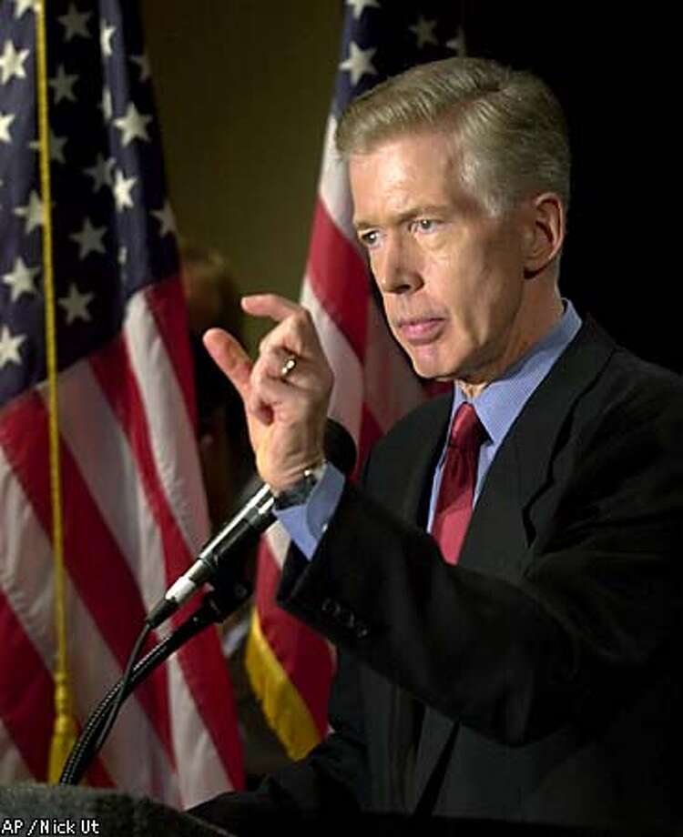 Gov. Gray Davis said at a press conference yesterday that he will sue federal regulators if they refuse to impose temporary price controls on electricity sold into the state. Associated Press photo by Nick Ut