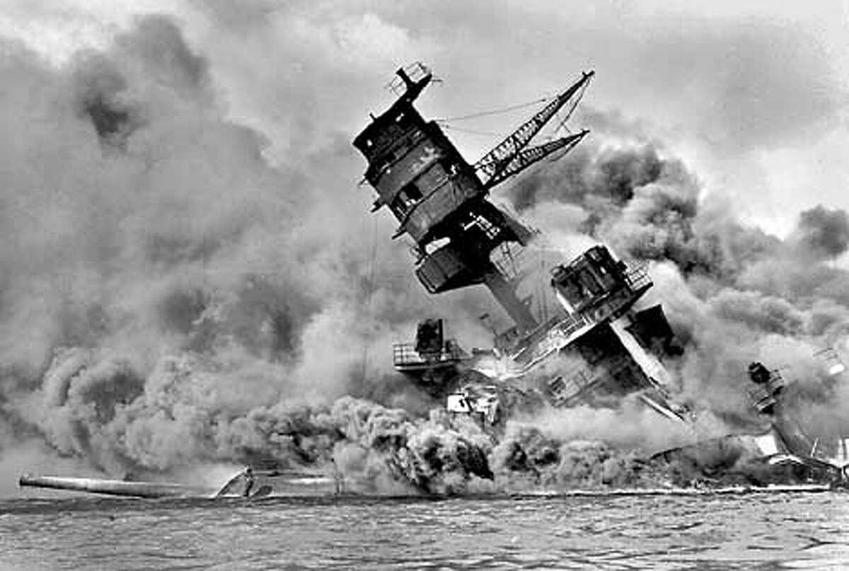 the USS Arizona goes down in Pearl Harbor, Dec. 7, 1941.
