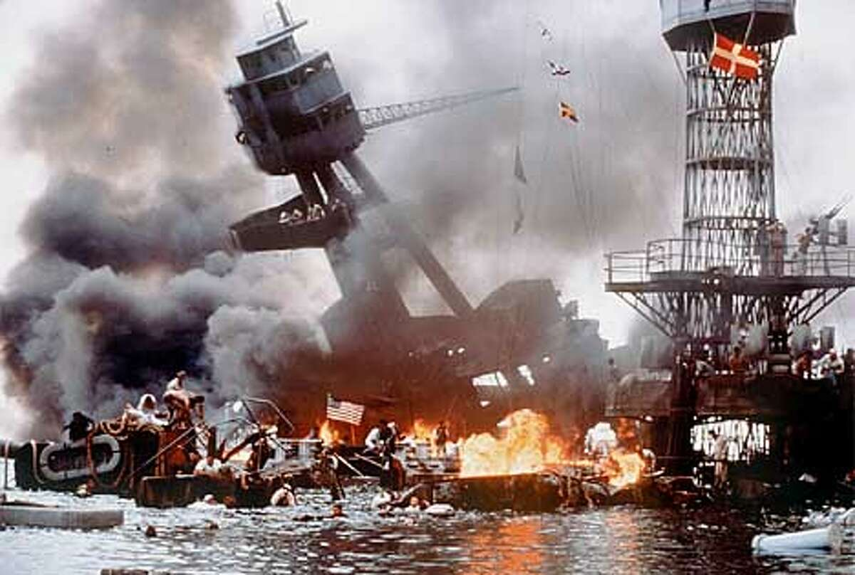"""The Japanese surprize attack on Pearl Harbor successfully decimates the U.S. Pacific Fleet, including the USS Arizona (tilted) in Touchtone Pictures'/Jerry Bruckheimer Films' epic drama, """"Pearl Harbor."""" The film is distributed by Buena Vista Pictures Distribution."""