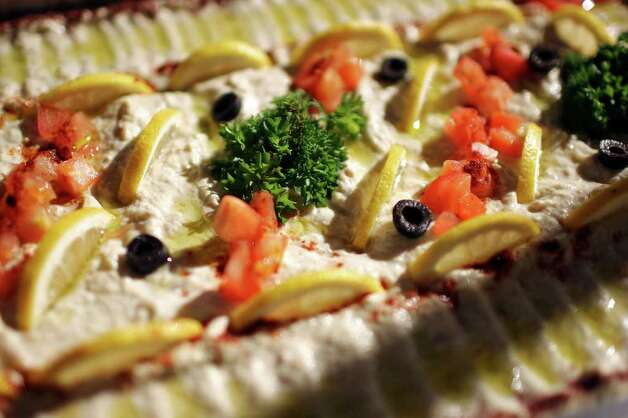 FOR TASTE - Detail of the Baba Ghanoush at Albustan Thursday Jan. 26, 2012. Photo: EDWARD A. ORNELAS, SAN ANTONIO EXPRESS-NEWS / © San Antonio Express-News (NFS)