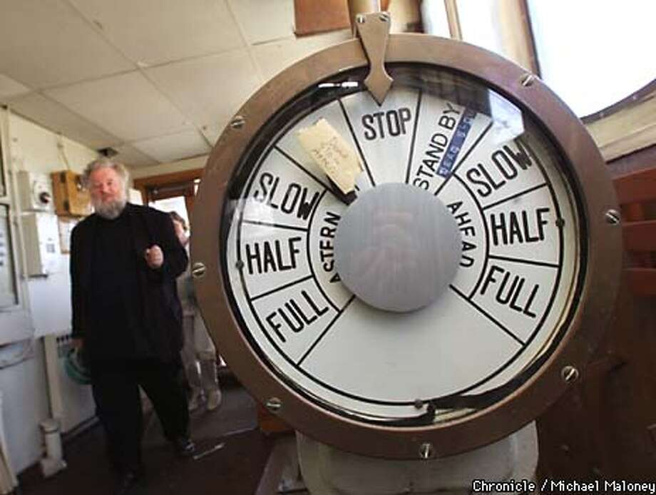 Slobodan Paich walks thru the pilothouse of the Golden Bear where the throttle controls are. Paich is the executive artistic director of the Artship project. The ship has served time as an art deco luxury liner, a World War II troop transport and a maritime academy. Now, it will be christened the Artship and dock at the Port of Oakland as a combination gallery/performance space/cafe, as well as the U.S. headquarters of the International Peace University.  CHRONICLE PHOTO BY MICHAEL MALONEY Photo: MICHAEL MALONEY