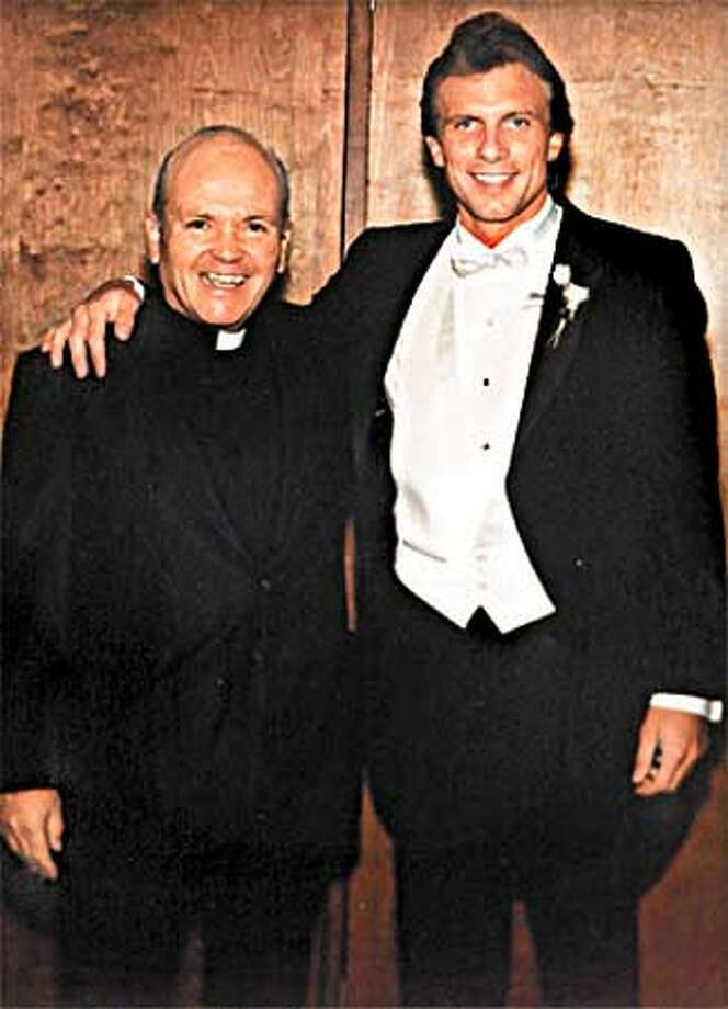 Monsignor Peter Armstrong poses with 49ers quarterback Joe Montana at Montana's wedding. The Rev. presided over the wedding as he has been the 49ers chaplain for years. By Brant Ward/Chronicle Photo: BRANT WARD