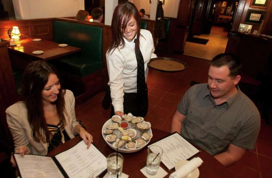 Give a really, really, really big tip. Photo: Patric Scheider / Houston Chronicle