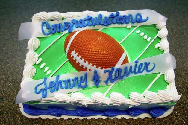 A cake for Lanier football players Johnny Vizcaino and Zavier Perez Coley is seen Wednesday Feb. 1, 2012 at Lanier High School, as the two becoming the first football players in Lanier's long history to sign national letters of intent to four-year institutions, according to school officials.